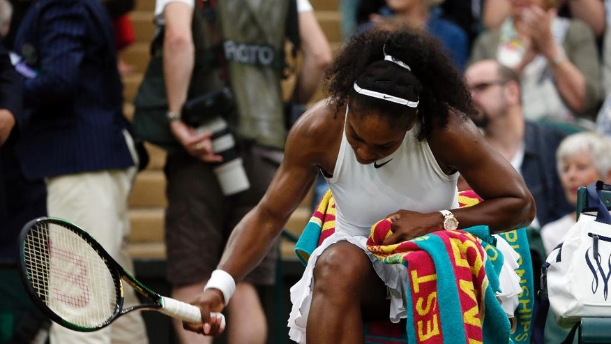 Serena Williams of the U.S smashes her racket after losing her first set to Christina McHale of the U.S during their women's singles match on day five of the Wimbledon Tennis Championships in London, Friday, July 1, 2016. (AP Photo/Ben Curtis)