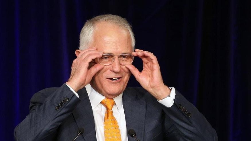 Australian Prime Minister Malcolm Turnbull addresses party supporters during a rally in Sydney, Sunday, July 3, 2016, following a general election. The elections, which pit the conservative coalition government against the center-left Labor Party, cap an extraordinarily volatile period in the nation's politics. (AP Photo/Rick Rycroft)