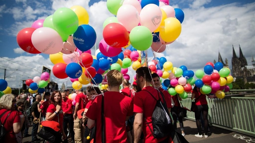 Participants gather for a Christopher Street Day parade in Cologne, western Germany, Sunday July 3, 2016. ( Maja Hitij/dpa via AP)