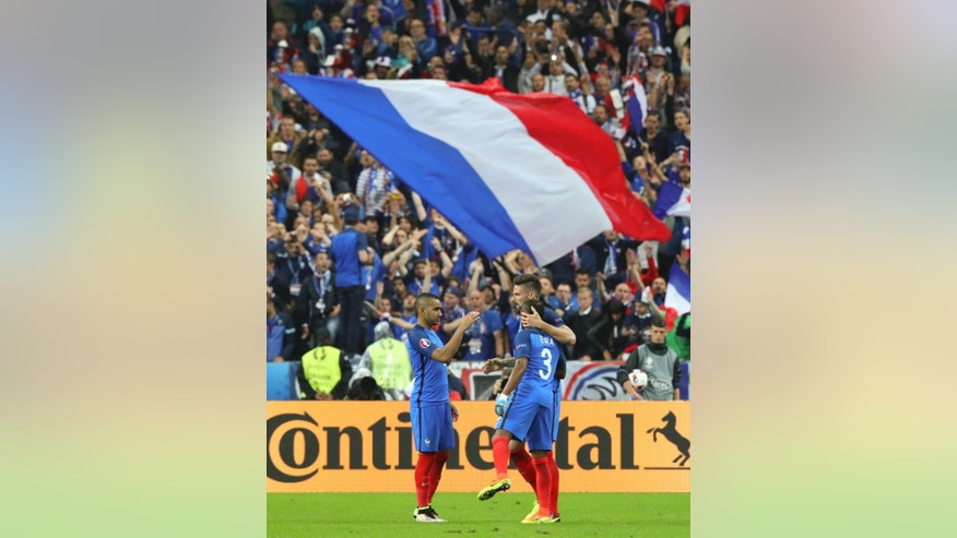 France's Olivier Giroud, right, celebrates with Patrice Evra and Dimitri Payet, left, after scoring his side's fifth goal during the Euro 2016 quarterfinal soccer match between France and Iceland, at the Stade de France in Saint-Denis, north of Paris, France, Sunday, July 3, 2016. (AP Photo/Thibault Camus)