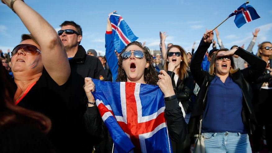 Iceland soccer fans watch the Euro 2016 quarterfinal match between Iceland and France on a large screen in Reykjavik, Iceland, Sunday July 3, 2016. (AP Photo/Brynjar Gunnarsson)