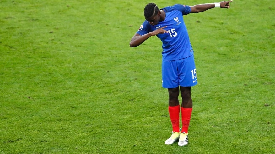 France's Paul Pogba celebrates after scoring his side's second goal  during the Euro 2016 quarterfinal soccer match between France and Iceland, at the Stade de France in Saint-Denis, north of Paris, France, Sunday, July 3, 2016. (AP Photo/Michael Sohn)