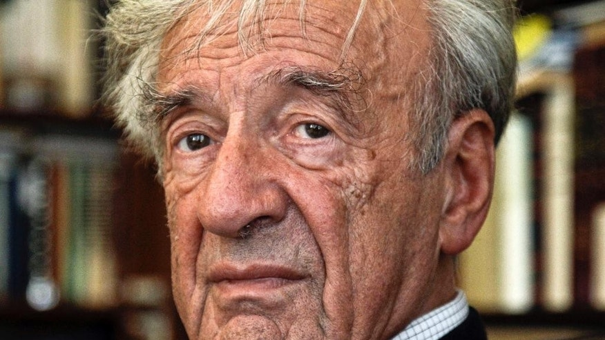 FILE - In this Sept. 12, 2012, photo Elie Wiesel is photographed in his office in New York. Israel's Yad Vashem Holocaust Memorial says Elie Wiesel has died at 87. Elie Wiesel never lived in Israel, but the death of the esteemed author and Nobel peace laureate is being treated in Israel like the loss of a national icon. As perhaps the world's most famous Holocaust survivor, Wiesel was championed in Israel as a symbol of the Jewish people's journey from the depths of darkness to the redemption of having a land of their own. (AP Photo/Bebeto Matthews, File)