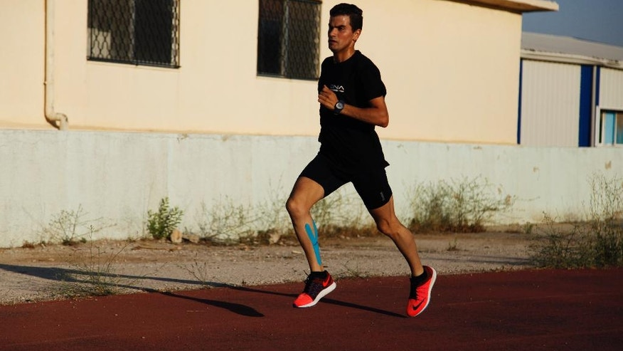 In this Saturday, June 25, 2016 photo, Mo'ath al-Khawaldeh does long distance running training at the Sports City race track in Amman, Jordan. While fasting during the Islamic holy month of Ramadan, Al-Khawaldeh is training twice seven days a week to prepare for the 2016 Berlin Marathon and to qualify for the 2020 Tokyo Olympics. (Sam McNeil/AP Photo)