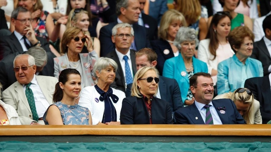 Former tennis star Martina Navratilova, front centre, and her wife Julia Lemigova, front left, sit in the Royal Box during day seven of the Wimbledon Tennis Championships in London, Sunday, July 3, 2016. (AP Photo/Alastair Grant)