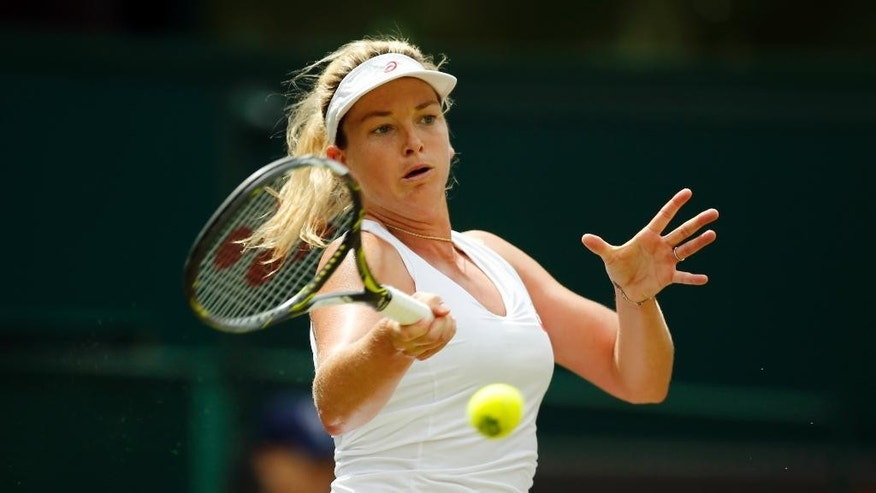 Coco Vandeweghe of the U.S returns to Roberta Vinci of Italy during their women's singles match on day seven of the Wimbledon Tennis Championships in London, Sunday, July 3, 2016. (AP Photo/Ben Curtis)
