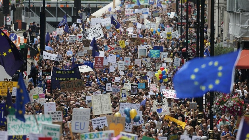 """Remain"" supporters near Park Lane in London, before marching to Parliament Square to show their support for the European Union in the wake of the referendum decision for Britain to leave the EU, known as ""Brexit"", Saturday July 2, 2016. Demonstrators wearing EU flags as capes and with homemade banners saying ""Bremain"" and ""We Love EU"" gathered on the streets around Park Lane for the March for Europe rally. (Daniel Leal-Olivas/PA via AP)"