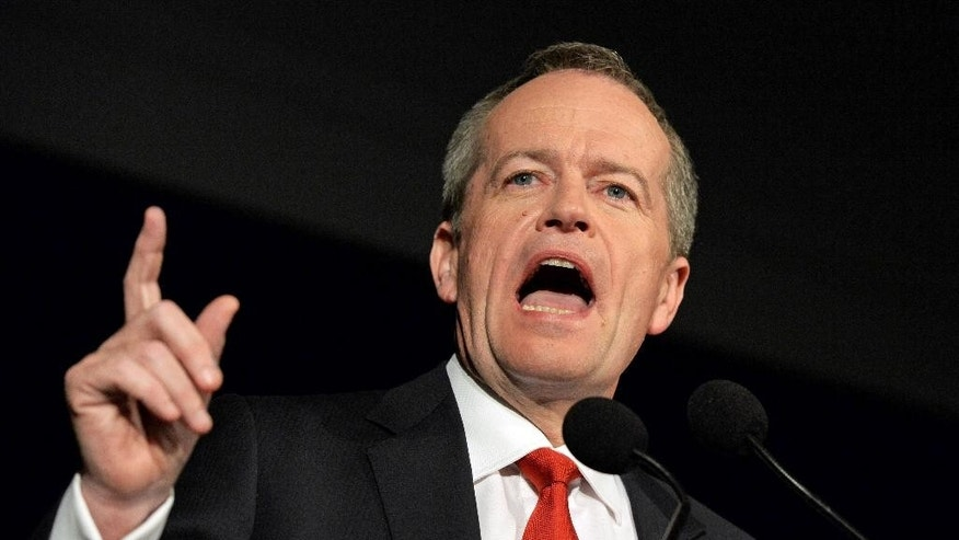 Australian leader of the opposition Bill Shorten addresses party members during the Labor party election night event in Melbourne, Australia, Saturday, July 2, 2016. The elections, which pit the conservative coalition government against the center-left Labor Party, cap an extraordinarily volatile period in the nation's politics. (Mick Tsikas/AAP Image via AP)