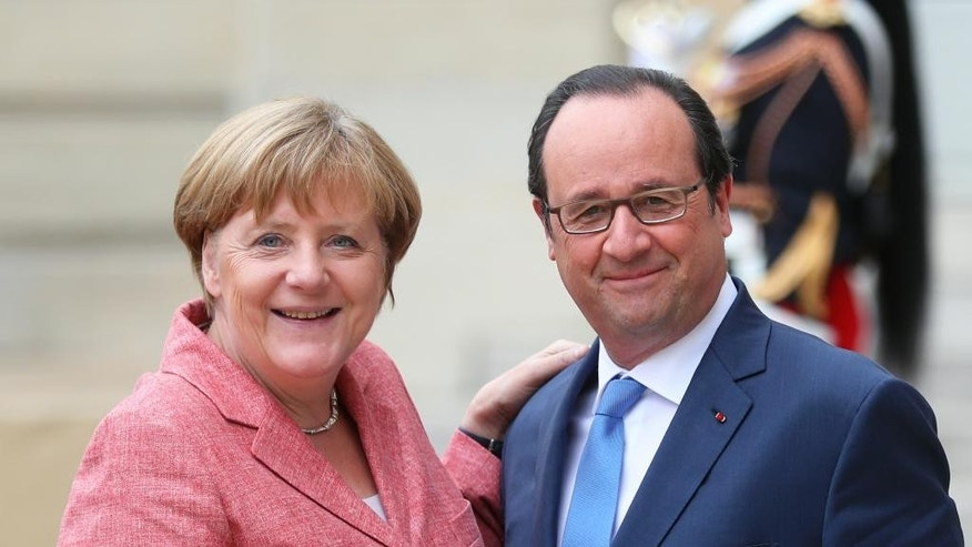 France's President Francois Hollande, right, poses with German Chancellor Angela Merkel, prior to the Balkans summit, at the Elysee Palace, in Paris, Monday, July 4, 2016. The leaders of France, Germany, Italy and Balkan nations are meeting to better prevent extremists from sneaking in with migrants who are moving west across Europe. (AP Photo/Thibault Camus)