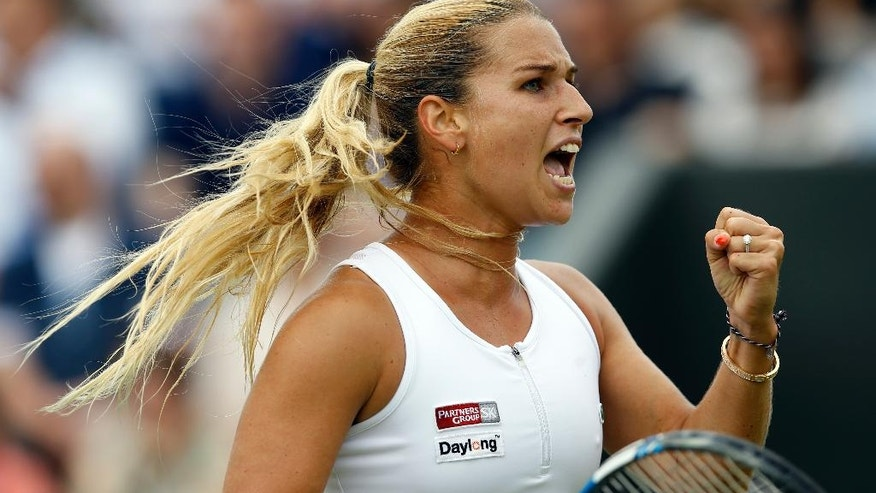 Dominika Cibulkova of Slovakia celebrates a point against Agnieszka Radwanska of Poland during their women's singles match on day eight of the Wimbledon Tennis Championships in London, Monday, July 4, 2016. (AP Photo/Kirsty Wigglesworth)