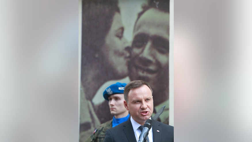 Poland's President Andrzej Duda speaks during commemorations marking the 70th anniversary of a massacre of Jews in Kielce, Poland, Monday, July 4, 2016. Duda has strongly condemned all forms of racism, xenophobia and anti-Semitism, saying there is no room in today's free Poland for those forms of prejudice. (AP Photo/Czarek Sokolowski)