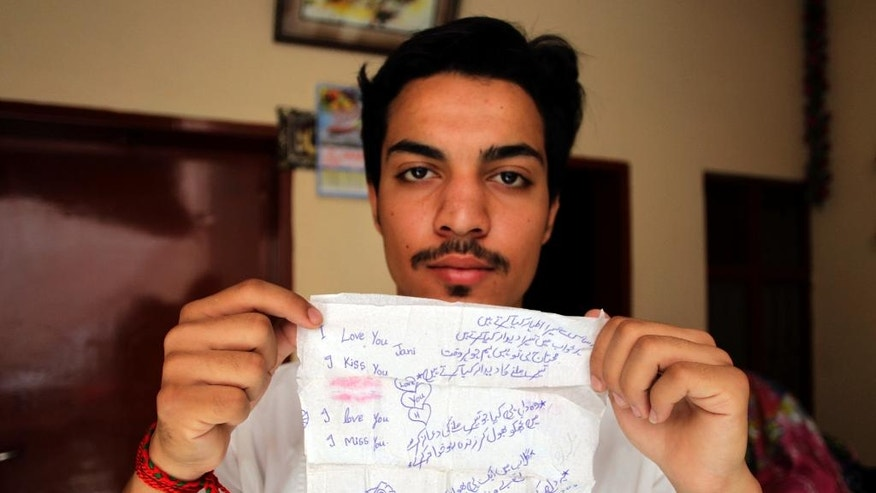 "In this June 11, 2016 photo, Hassan Khan shows a tissue on which his wife Zeenat wrote a poem and messages to him, in Lahore, Pakistan. Zeenat was the third Pakistani girl reported to have died in the last month in what has widely come to be known as an ""honor"" killing. They are so named because the victim is accused by family, would-be suitors, and in one case a tribal council, of bringing shame or dishonor to their households. At a hospital in Lahore in eastern Punjab province, where Zeenat was killed, one official said he knew of three other similar attacks that had gone unreported. (AP Photo/K.M. Chaudary)"