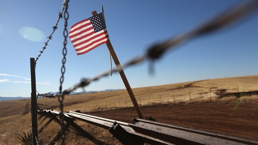 SONOITA, AZ - FEBRUARY 26:  An American flag flies at the U.S.-Mexico border on February 26, 2013 near Sonoita, Arizona. The Federal government has increased the Border Patrol presence in Arizona, from some 1,300 agents in the year 2000 ro 4,400 in 2012. The apprehension of undocumented immigrants crossing into the U.S. from Mexico has declined during that time from 600,016 in 2000 to 123,000 in 2012.  (Photo by John Moore/Getty Images)