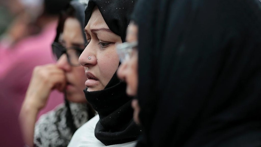 Relatives and friends of the victims of the attack on Holey Artisan Bakery attend a ceremony to pay tribute to the deceased, at a stadium in Dhaka, Bangladesh, Monday, July 4, 2016. The assault on the restaurant in Dhaka's diplomatic zone by militants who took dozens of people hostage marks an escalation in militant violence in the Muslim-majority nation. (AP Photo)