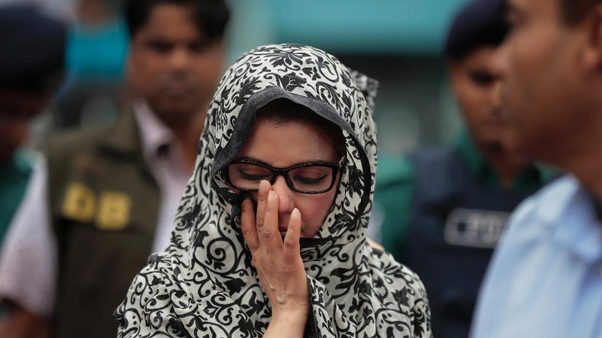 An unidentified relative of one of the victims of the attack on Holey Artisan Bakery reacts as people pay tribute to the deceased, at a stadium in Dhaka, Bangladesh, Monday, July 4, 2016. The assault on the restaurant in Dhaka's diplomatic zone by militants who took dozens of people hostage marks an escalation in militant violence in the Muslim-majority nation. (AP Photo)