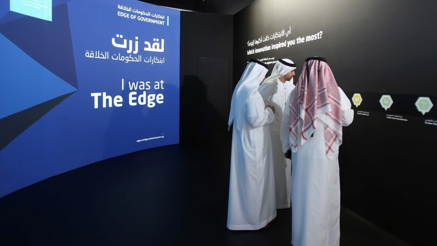 FILE -- In this Feb. 8, 2016 file photo, Emirati officials visit an exhibition at the World Government Summit in Dubai, United Arab Emirates.