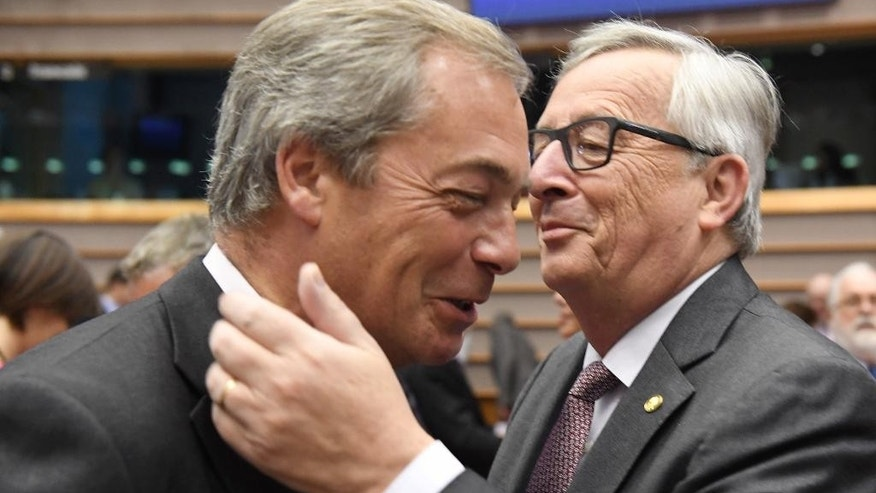 FILE - A Tuesday, June 28, 2016 photo from files showing European Commission President, Jean-Claude Juncker, right, greeting United Kingdom Independence Party leader, Nigel Farage, during a special session of European Parliament in Brussels on Tuesday. Farage announced on Monday July 4, 2016 that he is resigning as leader of the party. (AP Photo/Geert Vanden Wijngaert, File)