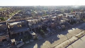 This image made from aerial drone footage released by the International Committee of the Red Cross on Monday, July 4, 2016 shows destruction in Ramadi, Iraq. New aerial footage of Ramadi shows the scale of the destruction as ICRC's president called on leaders to protect civilians and help channel assistance to families. When Iraqi government forces backed by U.S.-led warplanes wrested this city from Islamic State militants after eight months of IS control, it was heralded as a major victory. But the cost of winning Ramadi has been the city itself. (ICRC via AP)