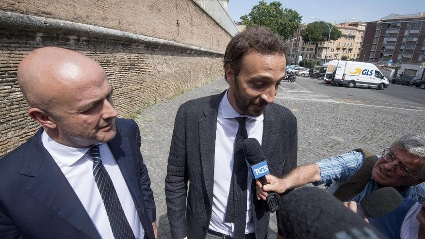 Italian journalists Gianluigi Nuzzi, left, and Emiliano Fittipaldi, arrive for a hearing of their trial, at the Vatican, Monday, July 4, 2016.  Two Italian journalists who wrote books detailing Vatican mismanagement face trial in a Vatican courtroom along with three people accused of leaking them the information in a case that has drawn scorn from media watchdogs. (Maurizio Brambatti/ANSA via AP Photo)