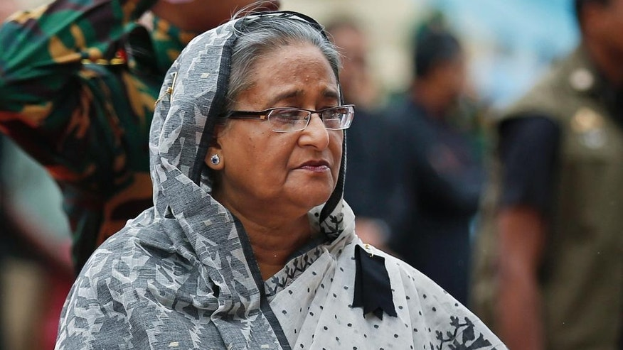 FILE - In this  July 4, 2016, file photo, Bangladeshi Prime Minister Sheikh Hasina offers her tribute to the victims of an attack on Holey Artisan Bakery, at a stadium in Dhaka, Bangladesh. The July 1, 2106 deadly restaurant attack in Dhaka speaks to a deeper divide that has pitted secularists against those yearning for Islamic rule since Bangladesh won independence in 1971. In recent years, Hasina has cracked down on the myriad of militant groups in Bangladesh, banning many and arresting their leaders. Some were convicted in opaque war-crimes court proceedings of collaborating with Pakistani forces in committing wartime atrocities and were executed. (AP Photo/File)