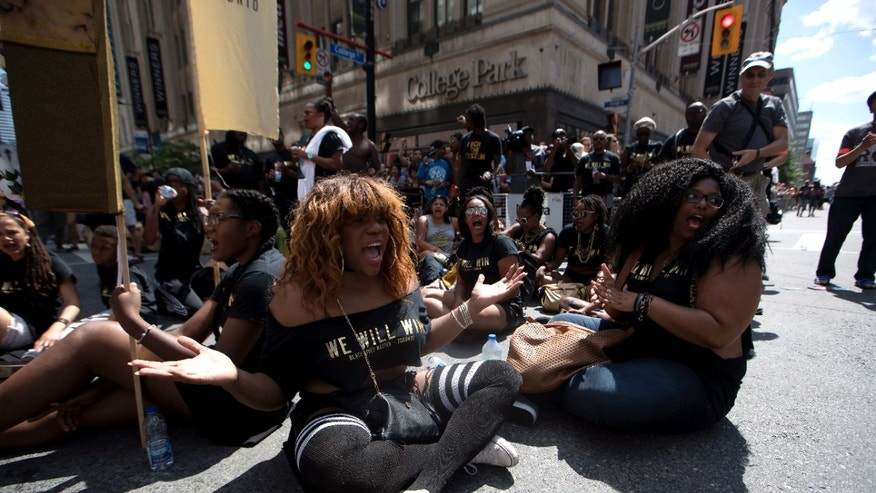 Members of the Black Lives Matters movement stage a sit-in at the annual Pride Parade in Toronto on Sunday, July 3, 2016. (Mark Blinch/The Canadian Press via AP)