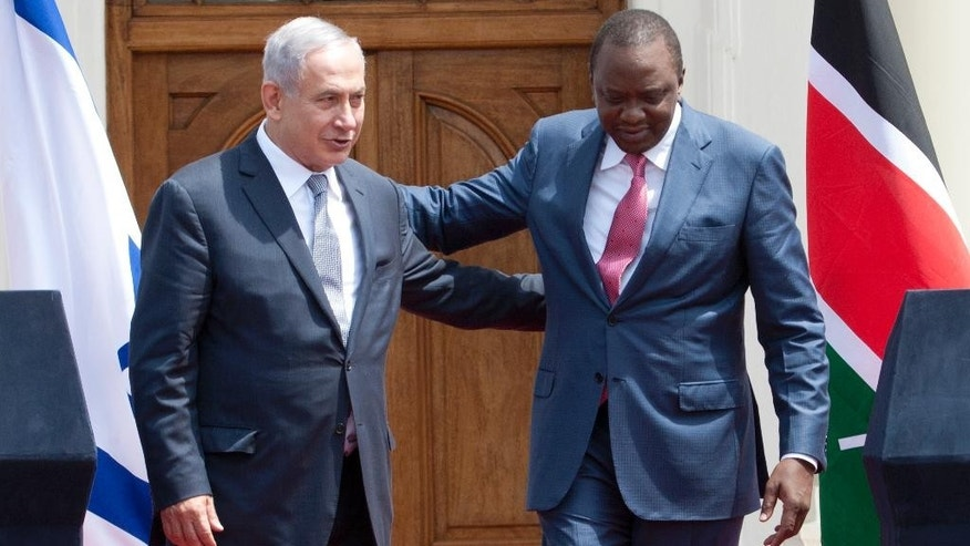 Israeli Prime Minister Benjamin Netanyahu, left, and Kenyan President, Uhuru Kenyatta, right, walk together after giving a joint press conference at State House in Nairobi, Kenya, Tuesday, July 5, 2016. Netanyahu is in Kenya as part of his four-nation tour of Africa. (AP Photo/Sayyid Abdul Azim)