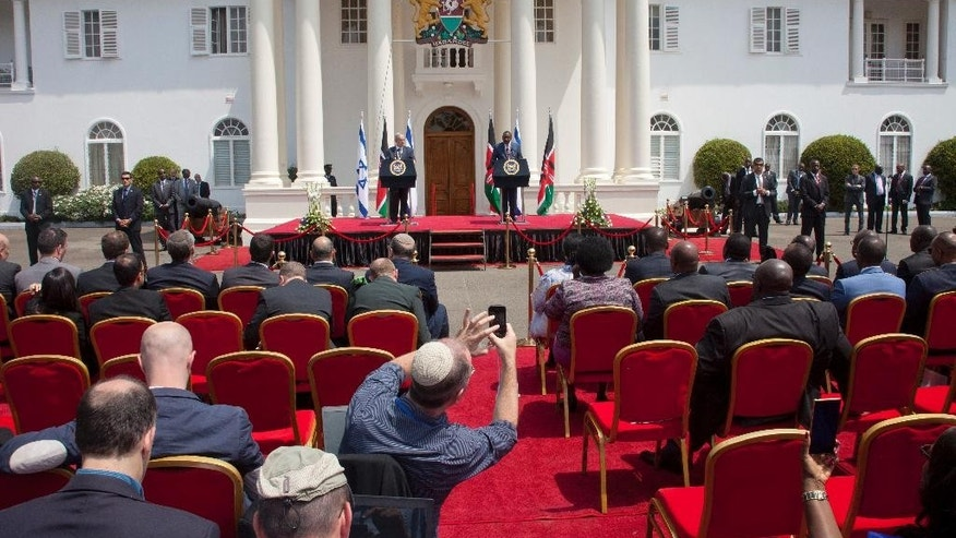 Delegates listen as Israeli Prime Minister Benjamin Netanyahu, and Kenyan President, Uhuru Kenyatta speak during a joint press conference as at State House in Nairobi, Kenya, Tuesday, July 5, 2016. Netanyahu is in Kenya as part of his four-nation tour of Africa. (AP Photo/Sayyid Abdul Azim)