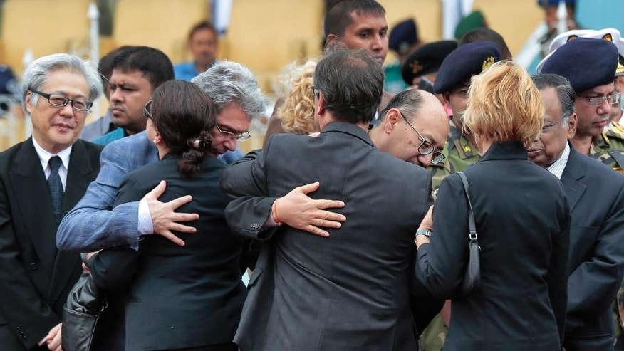 Foreign diplomats embrace each other as they attend a ceremony to offer tribute to the victims of the attack on Holey Artisan Bakery, at a stadium in Dhaka, Bangladesh, Monday, July 4, 2016. The assault on the restaurant in Dhaka's diplomatic zone by militants who took dozens of people hostage marks an escalation in militant violence in the Muslim-majority nation. (AP Photo)