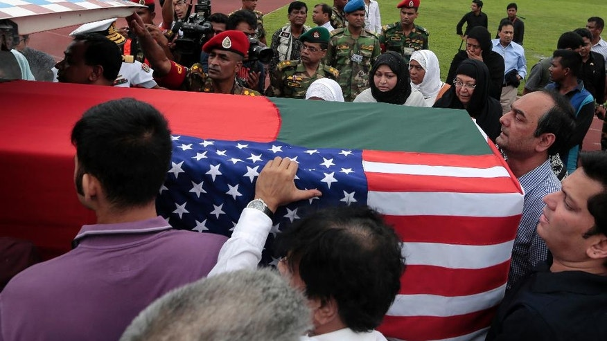 Relatives of Abinta Kabir, a student of Emory University in the U.S, carry her body after a ceremony to pay tribute to the victims of the attack on Holey Artisan Bakery, in Dhaka, Bangladesh, Monday, July 4, 2016. The assault on the restaurant in Dhaka's diplomatic zone by militants who took dozens of people hostage marked an escalation in militant violence in the Muslim-majority nation. (AP Photo)