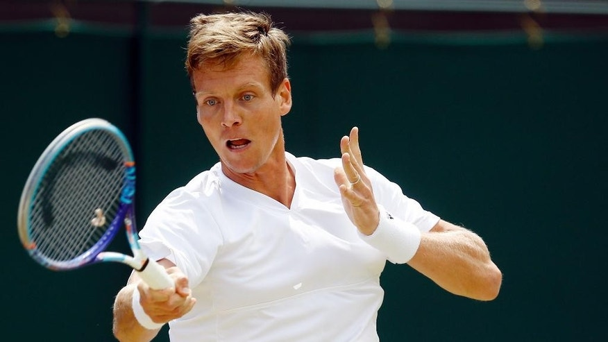 Tomas Berdych of the Czech Republic returns to Jiri Vesely of the Czech Republic during their men's singles match on day nine of the Wimbledon Tennis Championships in London, Tuesday, July 5, 2016. (AP Photo/Kirsty Wigglesworth)