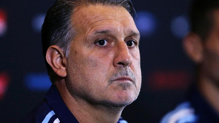 FILE - In this June 17, 2016 file photo, Argentina's soccer coach Gerardo Martino listens to a reporter's question before practice at Gillette Stadium in Foxborough, Mass. Argentina's Futbol Association confirmed on July 5, 2016 that Martino resigned from his post. (AP Photo/Charles Krupa, File)