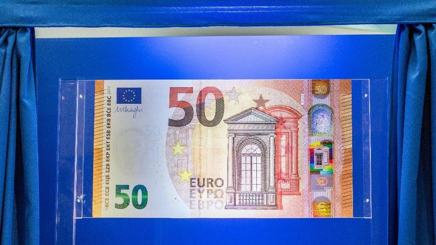 Tthe new 50 euro banknote is presented at the headquarters of the European Central Bank, ECB,in Frankfurt, central Germany, Tuesday, July 5, 2016. (Frank Rumpenhorst/dpa via AP)