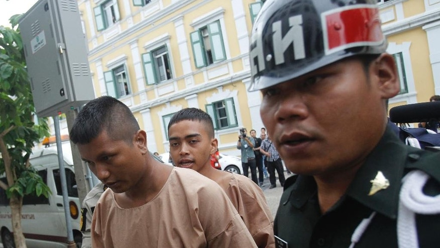 Members of the New Democracy Movement (NDM) group arrive in police custody at the military court in Bangkok, Thailand, Tuesday, July 5, 2016. Human rights groups expressed their concerns that the students were arrested for exercising their rights to the freedom of expression ahead of the Aug. 7, 2016, referendum on the draft constitution. (AP Photo/Sakchai Lalit)