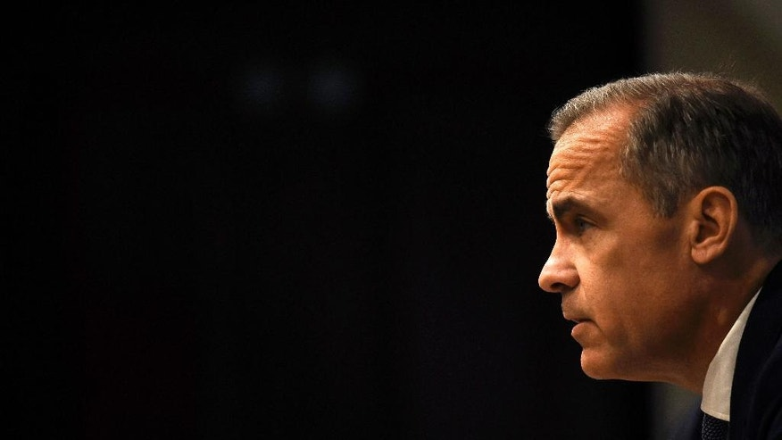Bank of England governor Mark Carney speaks during a news conference at the Bank of England in London, Tuesday, July 5, 2016. Carney says some of the risks predicted to the economy before the referendum on leaving the European Union have begun to crystalize, but that the institution will act to support jobs and growth. (Dylan Martinez/ Pool via AP)