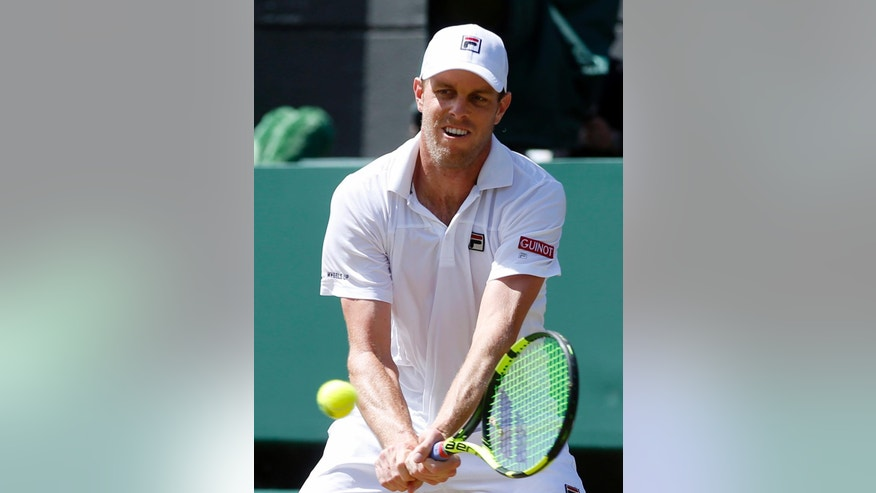 Sam Querrey of the U.S returns to Milos Raonic of Canada during their men's singles match on day ten of the Wimbledon Tennis Championships in London, Wednesday, July 6, 2016. (AP Photo/Alastair Grant)