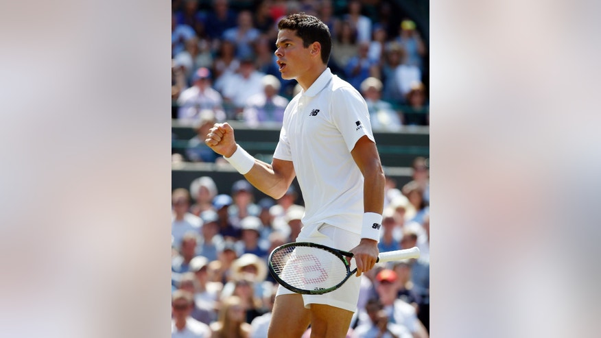 Milos Raonic of Canada celebrates a point against Sam Querrey of the U.S during their men's singles match on day ten of the Wimbledon Tennis Championships in London, Wednesday, July 6, 2016. (AP Photo/Alastair Grant)