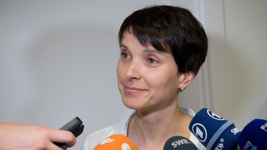 Frauke Petry, co-leader of the party Alternative for Germany or AfD answers the questions of journalists in Stuttgart, Germany, Wednesday, July 6, 2016. An argument over a regional lawmaker accused of anti-Semitism has laid bare divisions in the leadership of the German nationalist party that has been boosted by Europe's migrant crisis. (Bernd Weissbrod/dpa via AP)