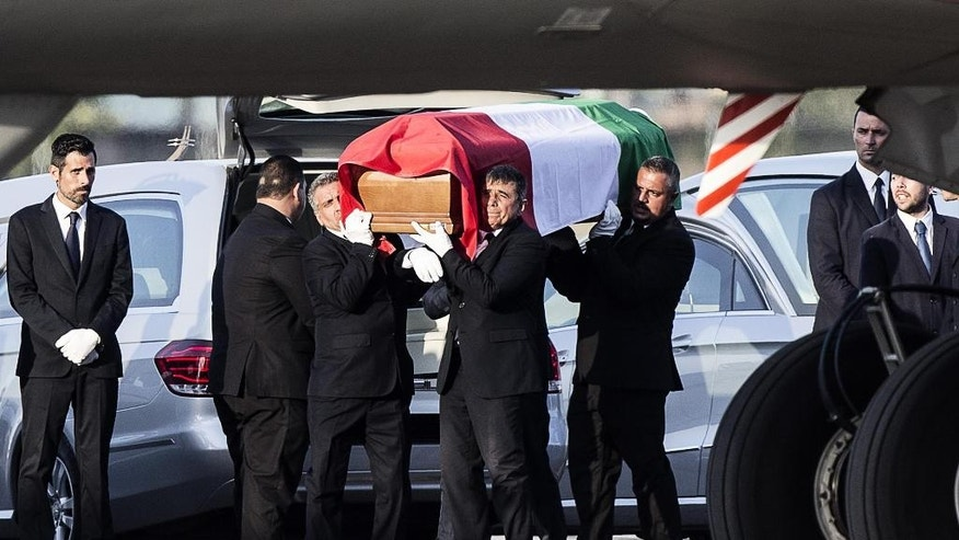 The coffin of one of the nine Italian victims, who were killed in the July 1 attack in the Bangladeshi capital of Dhaka, is shoulder carried at Rome's Ciampino military airport, Tuesday, July 5, 2016. The brutality of the attack, the worst convulsion of violence yet in the recent series of deadly attacks to hit Bangladesh, has stunned the traditionally moderate Muslim nation and raised global concerns about whether it can cope with the increasingly strident Islamist militants. (Angelo Carconi/ANSA Via AP)