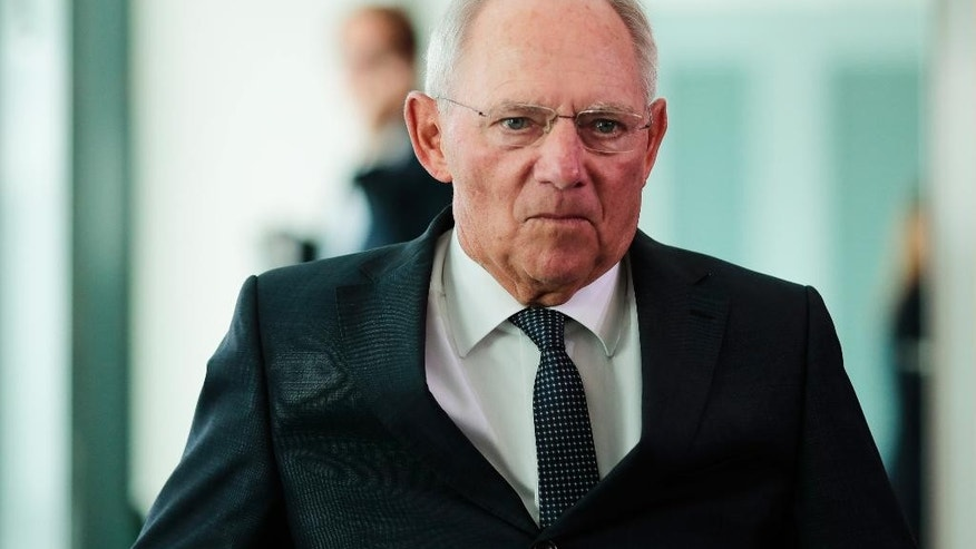 German Finance Minister Wolfgang Schaeuble arrives for the cabinet meeting at the chancellery in Berlin, Wednesday, July 6, 2016. The cabinet will decide about the German budget 2017 and the finance planing until 2020. (AP Photo/Markus Schreiber)
