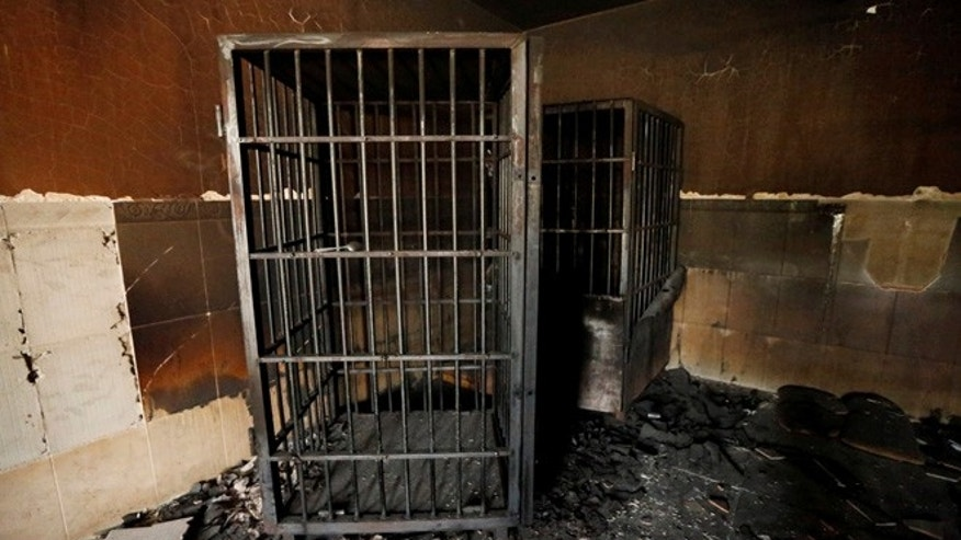 A burnt out prison cell belonging to Islamic State militants is seen in Falluja after government forces recaptured the city from Islamic State militants, Iraq, June 27, 2016. REUTERS/Thaier Al-Sudani - RTX2IIW5
