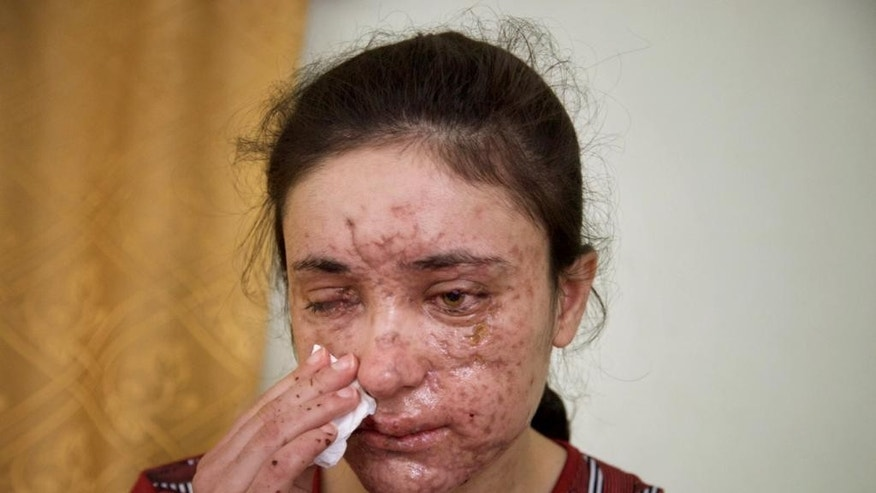 Lamiya Aji Bashar, an 18-year-old Yazidi girl who escaped her ISIS enslavers, talks to The Associated Press in northern Iraq.