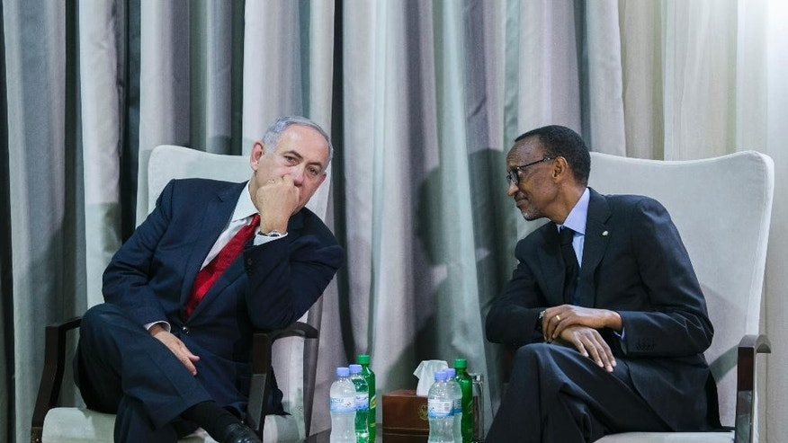 Israeli Prime Minister, Benjamin Netanyahu, left, and Rwandas President, Paul Kagame, right, in conversation before a joint press conference in Kigali, Rwanda, Wednesday, July 6, 2016. Netanyahu is on a one day visit to Rwanda and on a four-nation Africa tour. (AP Photo)