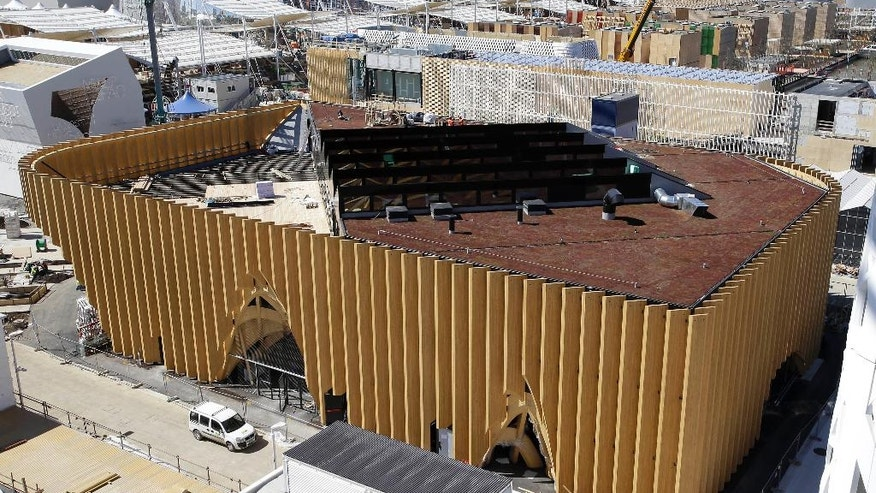 FILE - In this Thursday, April 2, 2015 file photo, a general view of the France pavilion under construction at the Expo site in Rho, in the outskirts of Milan, Italy. Prosecutors in Milan, Wednesday, July 6, 2016, say 11 people have been arrested in probe of Milan Expo construction contracts with links to the Sicilian Mafia. (AP Photo/Antonio Calanni, File)