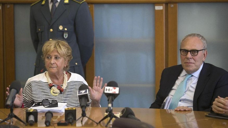 Italian prosecutors Ilda Boccassini, left, and Francesco Greco attend a press conference on a police operation which led to the arrest of 11 people in a probe of Milan Expo construction contracts with links to the Sicilian Mafia, in Milan, Italy, Wednesday, July 5, 2016. (Stefano Porta/ANSA Via AP)