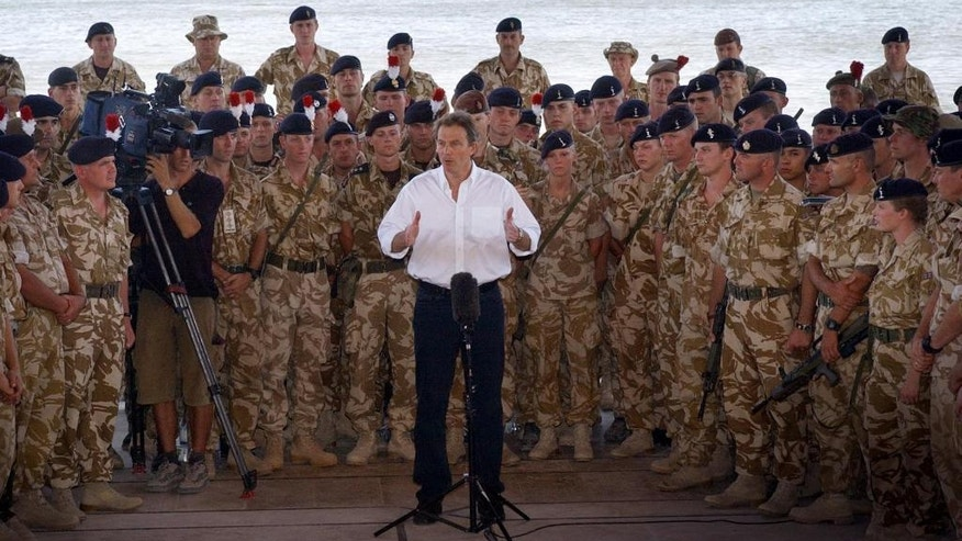 "FILE -- In this May 29, 2003 file photo, British Prime Minister Tony Blair addresses troops in Basra, Iraq. The head of Britain's Iraq War inquiry, retired civil servant John Chilcot, released a damning report Wednesday, July 6, 2016, on a conflict he said was mounted on flawed intelligence and executed with ""wholly inadequate"" planning. The 2.6-million-word report is an exhaustive verdict on a divisive conflict that — by the time British combat forces left in 2009 — had killed 179 British troops, almost 4,500 American personnel and more than 100,000 Iraqis. (AP Photo/Stefan Rousseau/WPA pool)"
