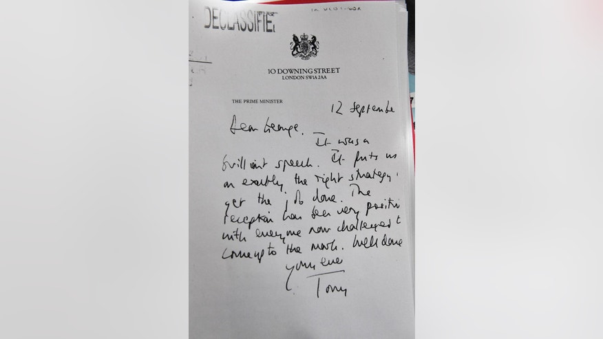 "A detail of a declassified handwritten letter sent by the then British Prime Minister Tony Blair, to former U.S President George W. Bush, is seen as part of the Iraq Inquiry Report presented by Sir John Chilcot at the Queen Elizabeth II Centre  in London, Wednesday, July 6, 2016. The head of Britain's Iraq War inquiry has released a damning verdict on a conflict he says was mounted on flawed intelligence, executed with ""wholly inadequate"" planning. (Jeff J Mitchell/Pool via AP)"