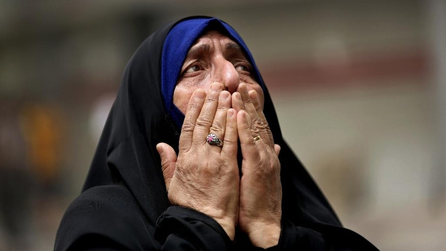 FILE -- In this Sunday July 3, 2016, file photo, an Iraqi woman grieves at the scene after a truck bomb attack in Karada, a busy shopping district in the center of Baghdad, Iraq. As millions of Muslims around the world celebrate the end of Ramadan, many are struggling to come to grips with what has been a particularly bloody month of attacks that killed more than 350 people and spread terror across continents. (AP Photo/Hadi Mizban, File)