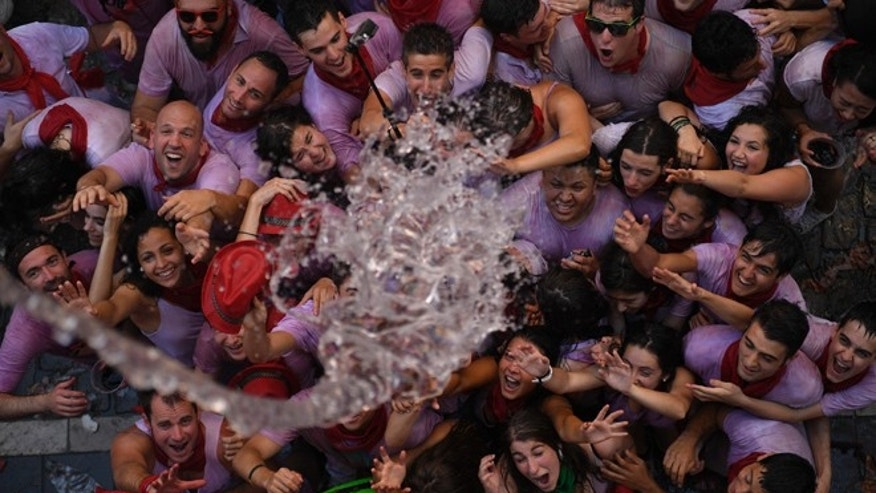 JULY 6: Water is thrown on to revelers during  the launch of the 'Chupinazo' rocket to celebrate the official opening of the 2016 San Fermin Fiestas.
