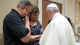 "Pope Francis meets Nick, left, and Jodi Solomon, the parents of Beau Solomon, a U.S. college student whose body was found in Rome's Tiber river this week, during private encounter shortly before holding an audience with French pilgrims in a Vatican auditorium, Wednesday, July 6, 2016. Francis expressed to Beau Solomon's parents ""feelings of deepest sympathy and compassion, and his closeness in prayer to the Lord for the young man who died so tragically."" (L'Osservatore Romano/Pool photo via AP)"