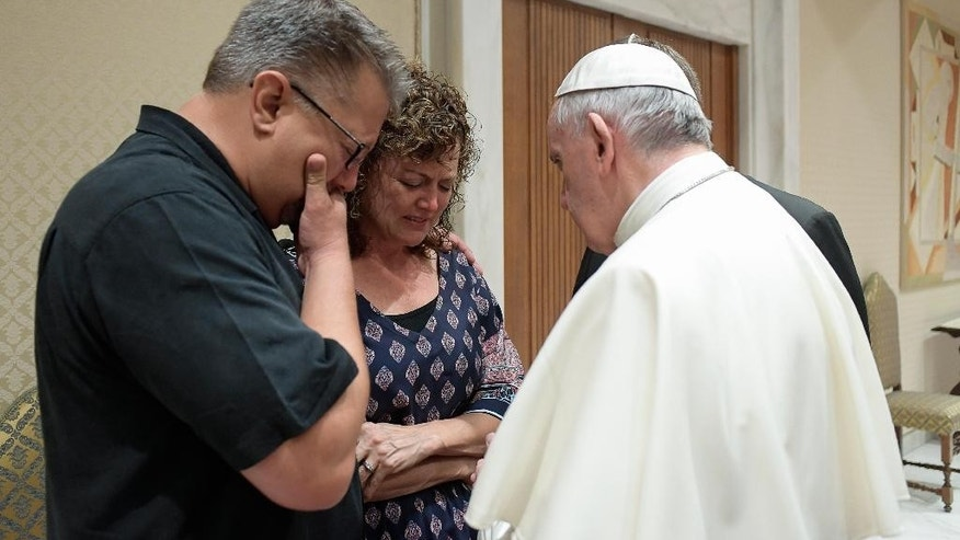 Pope Francis meets Nick, left, and Jodi Solomon, the parents of Beau Solomon, a Wisconsin student whose body was found in Rome's Tiber river this week.